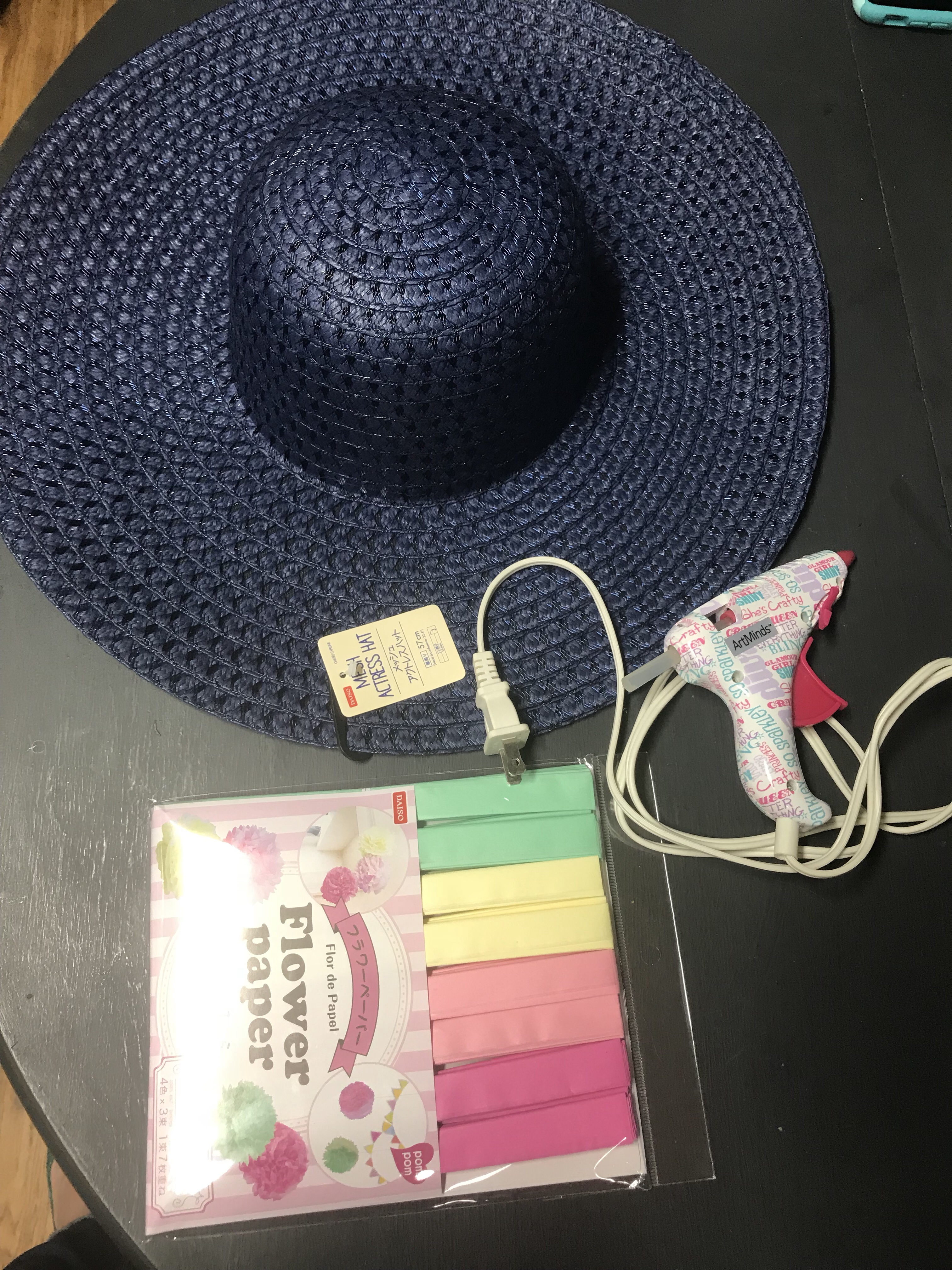 Straw hat and paper pom-poms from Daiso